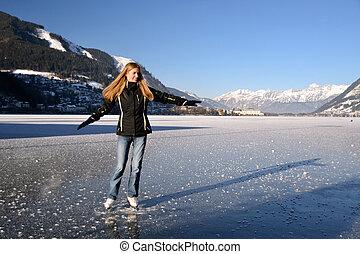Woman figure skating - Young woman figure skating at frozen...