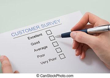 Woman Filling Customer Satisfaction Form