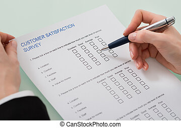 Woman Filling Customer Satisfaction Form - Close-up Of Woman...