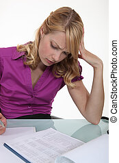 Woman filling in paperwork