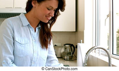 Woman filling pot with water in slow motion