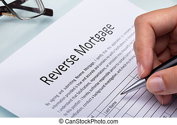 Woman Filling Reverse Mortgage Form