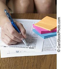Woman Filling Tax Form