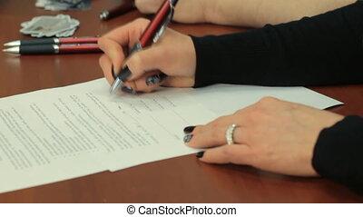 Woman fills an application form.