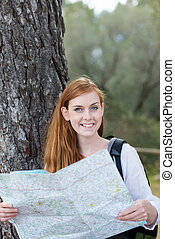 Woman finding her route on a map