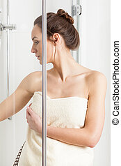 Woman finishing a shower