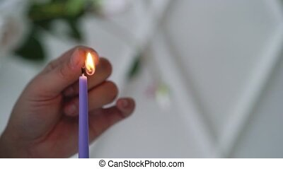Woman fire violet candle slowmotion