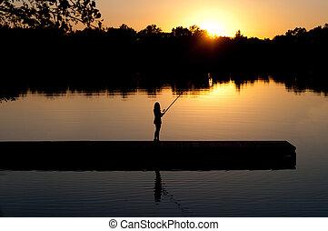 Woman Fishing at Sunset
