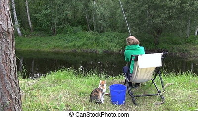 woman fishing carp cat - woman angler catch little crucian...