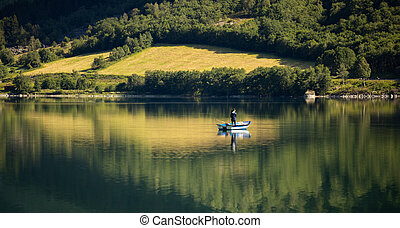 Woman fishing on a boat.