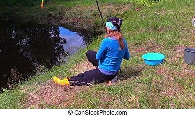 woman fishing rod cat