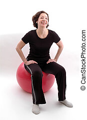 woman  fitness ball - smiling woman on fitness ball