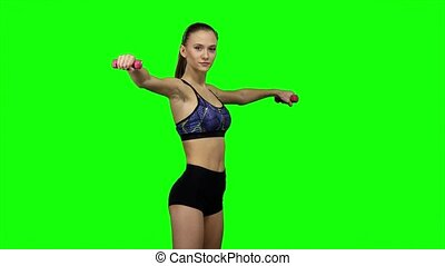 Woman fitness instructor doing exercises. Green screen