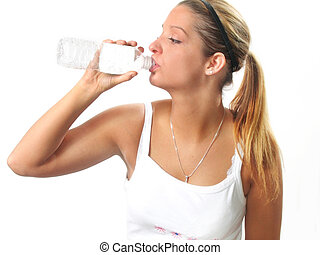 Woman Fitness Water - Young woman relaxes with bottled water...