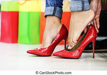 Woman fitting stilettos - Close up of woman fitting red ...