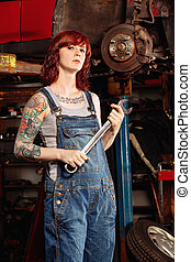 Woman fixing her car