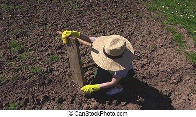 Woman fixing vintage plow