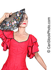 Woman flamenco dancer with red dress and open fan