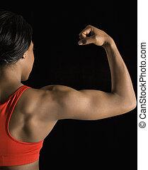 Woman flexing bicep.