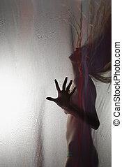 Woman flipping hair. - Sensual nude Caucasian woman behind...
