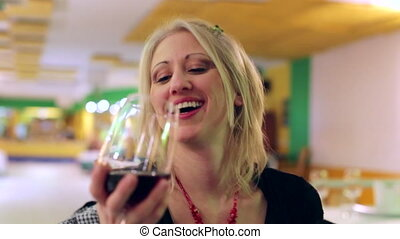 woman flirting and drinking
