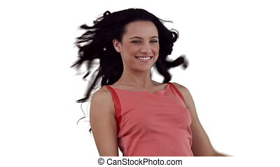 Woman flirting while looking at the camera against a white background