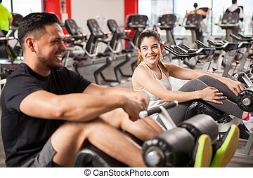 Woman flirting with a guy in a gym