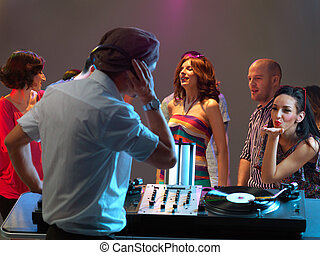 woman flirting with dj in night club