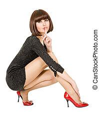 woman flirts squatting on white background