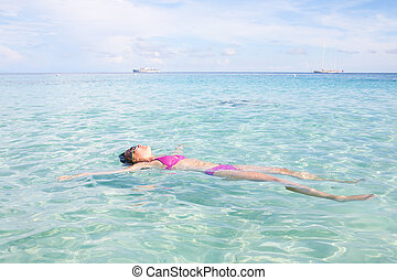 Woman Floating In Crystal Clear Water in Andaman Sea