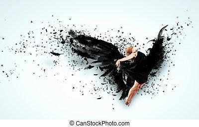 Woman floating   on dark wings