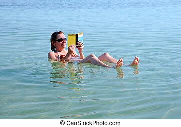 Woman Floats in the Dead Sea