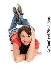 Woman Floor Smile - Beautiful young woman laying on floor...
