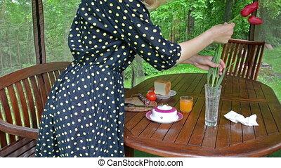 woman flower breakfast - Woman in spotted dress soak dap...