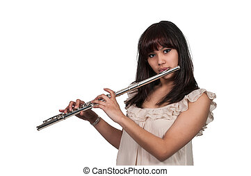 Beautiful young woman playing the musican instrument the flute