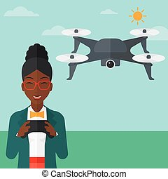 Woman flying drone. - An african-american woman flying drone...