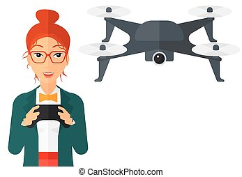 Woman flying drone. - A woman flying drone with remote...