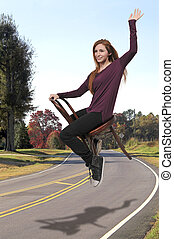 Woman flying in a chair - Beautiful young woman floating...