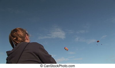 Woman Flying Stunt Kite - Woman (37 yr) flying a stunt kite...