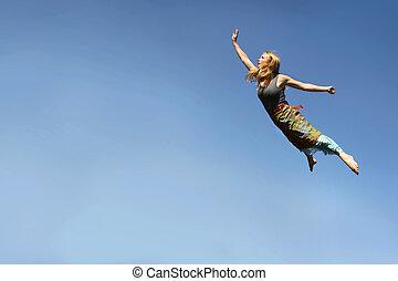 Woman Flying Through Blue Sky
