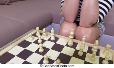 Woman focuses on chess playing