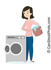 Woman folding washing machine.