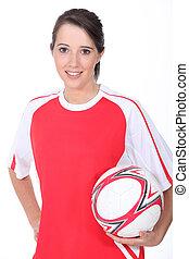 Woman football player