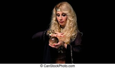 Woman fortune teller with crystal ball portrait on black