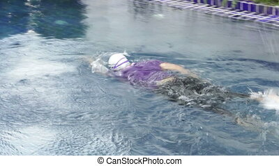 Woman freestyle in swimming pool - Woman freestyle diving in...