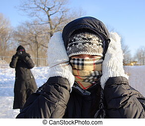 Woman freezing cold - Cold winter woman covering herself...