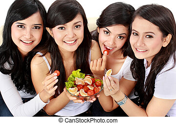 woman friend having salad together