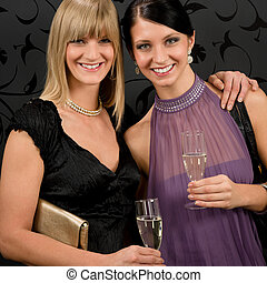 Woman friends party dress hold champagne glass