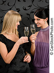 Woman friends party dress toast champagne glass
