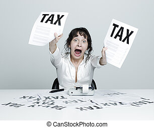 Woman frightened by taxes - Young desperate woman at her...
